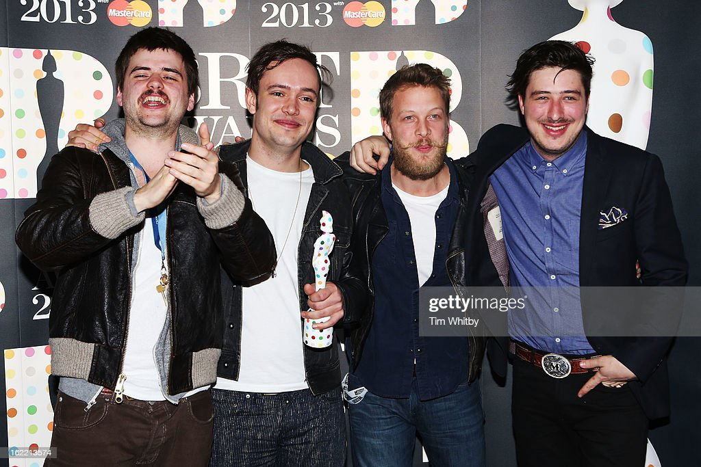 Winston-Marshall, <a gi-track='captionPersonalityLinkClicked' href=/galleries/search?phrase=Ben+Lovett&family=editorial&specificpeople=3039181 ng-click='$event.stopPropagation()'>Ben Lovett</a>, <a gi-track='captionPersonalityLinkClicked' href=/galleries/search?phrase=Ted+Dwane&family=editorial&specificpeople=5856816 ng-click='$event.stopPropagation()'>Ted Dwane</a> and <a gi-track='captionPersonalityLinkClicked' href=/galleries/search?phrase=Marcus+Mumford&family=editorial&specificpeople=5385533 ng-click='$event.stopPropagation()'>Marcus Mumford</a> of Mumford & Sons pose with their British Group award in the press room at the Brit Awards 2013 at the 02 Arena on February 20, 2013 in London, England.