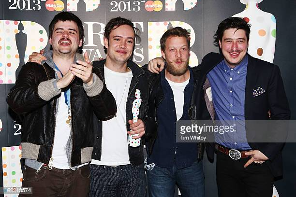 WinstonMarshall Ben Lovett Ted Dwane and Marcus Mumford of Mumford Sons pose with their British Group award in the press room at the Brit Awards 2013...