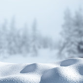 Winter background with a pile of snow and thick fog in the background. Copyspace for text