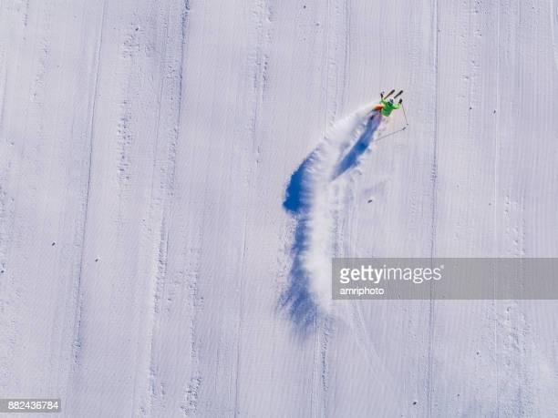 Winter Breaks - one skier skiing on ski piste aerial view