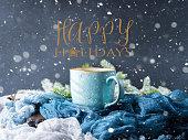 Mug of coffee and milk on dark blue winter background. Hot drink still life. Wishing happy holidays greeting card