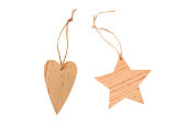 Winter, Christmas, New Year wooden pine tree decoration - natural brown star and heart. Isolated on white background. Wooden decor. Top view. Closeup with clipping path.