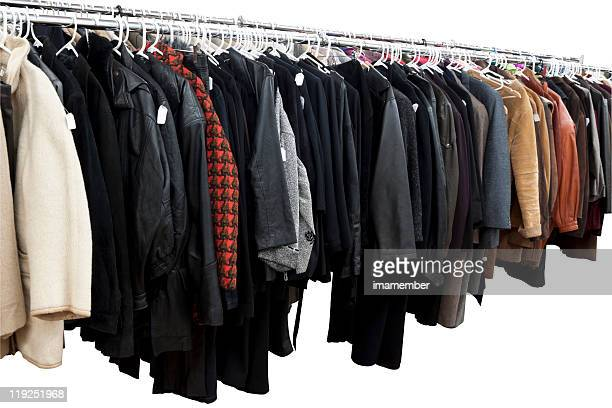 Winter Coats and jackets on rack isolated on white background