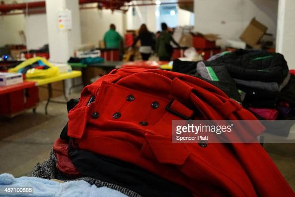 Winter coats sit in a warehouse at the annual New York Cares coat drive on December 16 2013 in New York City The drive for winter jackets for those...