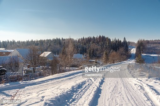 Winter country road and village. : Stock Photo