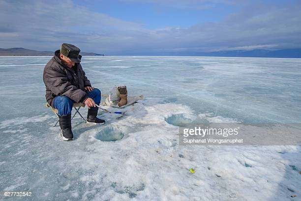 Fishing tackle photos et images de collection getty images for Frozen fishing pole