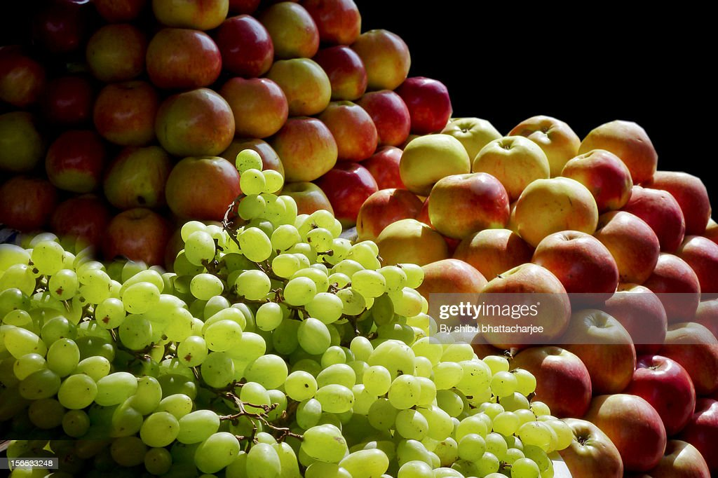 Winter fruits arrival in a shop in the village mar : Stock Photo