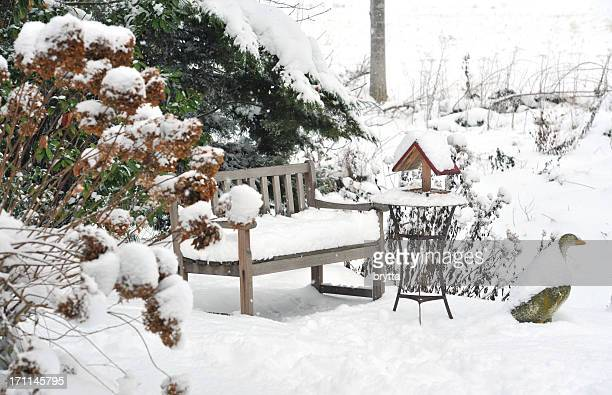 Winter garden with bench, bird feeder,side table ,stone goose