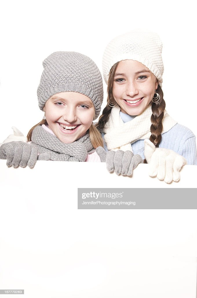 Winter Girls with Blank Sign : Stock Photo