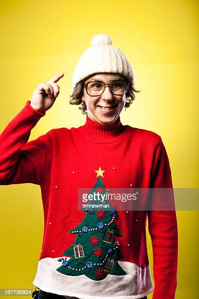 Winter Hat and Sweater Wearing Goofy Face Making Teen Boy