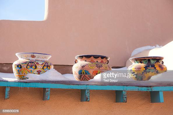 Winter in New Mexico American Indian pottery with snow in Taos New Mexico