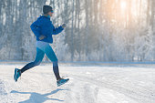 Winter Jogging - Winter Running in Snow. A healthy lifestyle