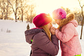 Winter kissing with mother and daughter
