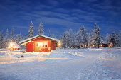 Winter landscape with cabin hut at night in Kiruna Lapland Sweden at Night with star trail