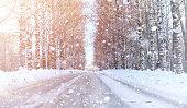 Winter landscape snow covered expanses. A park in the winter in the snow. Road on winter day.