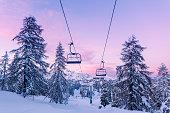 Winter mountains panorama with ski slopes and ski lifts near Vogel ski center, Slovenia