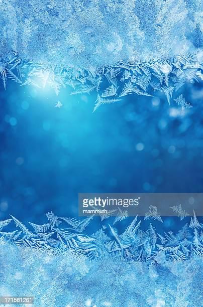 Winter night behind frozen window glass