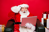 Winter noel december eve christmastime package. Aged mature Santa spectacles open mouth eyes white beard isolated red background look pc wondered astonishment face receive unbelievable email letter