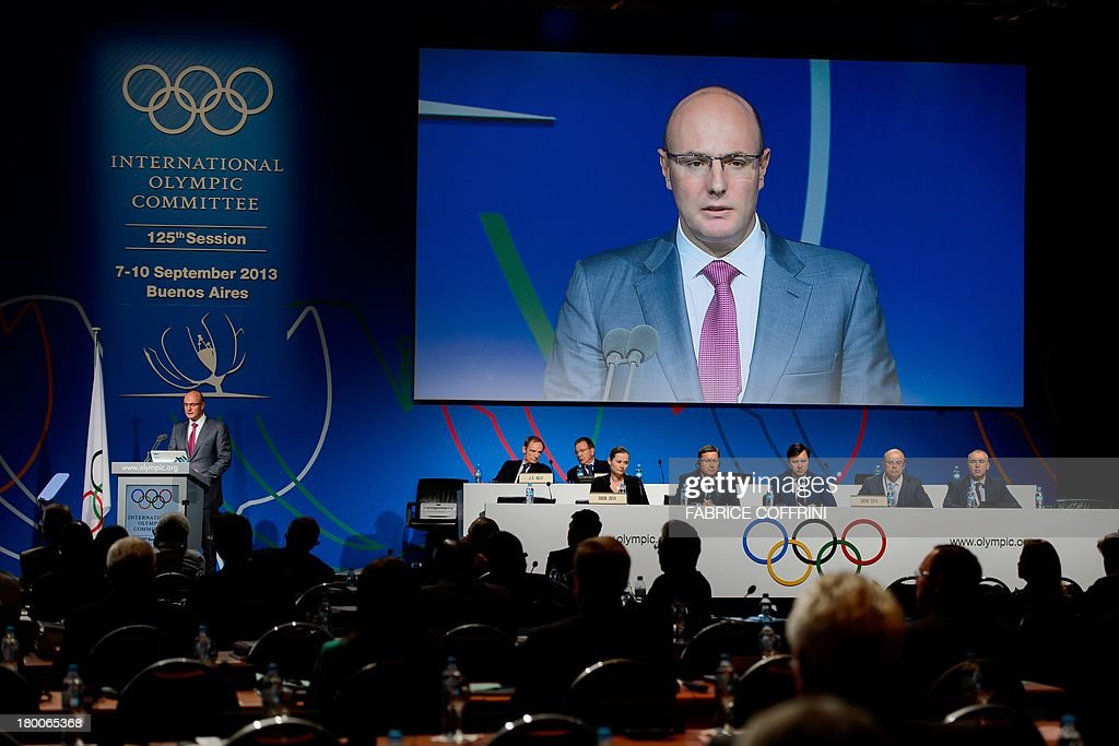 Winter Olympics Sochi 2014 President Dmitry Chernyshenko (L and on screen) delivers a speech during the reports of the Coordination Commission during the International Olympic Committe's 125th Session, in Buenos Aires, on September 8, 2013.