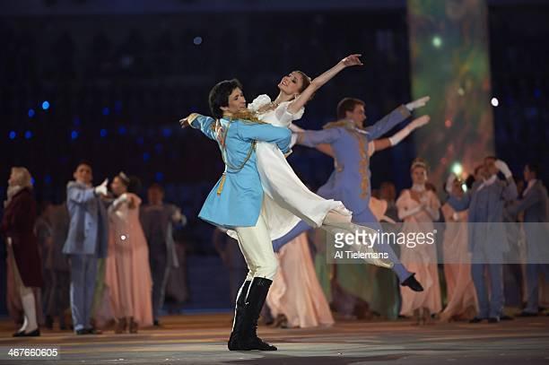 View of Danila Korsuntsev and Svetlana Zakharova performing Natasha Rostova's First Imperial Ball scene during opening ceremony at Fisht Olympic...