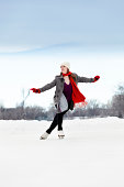 'Winter Outdoor Teenage Girl Ice Skater in Red Scarf, Gloves'