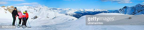Winter panorama Snow skier family mother and father with children