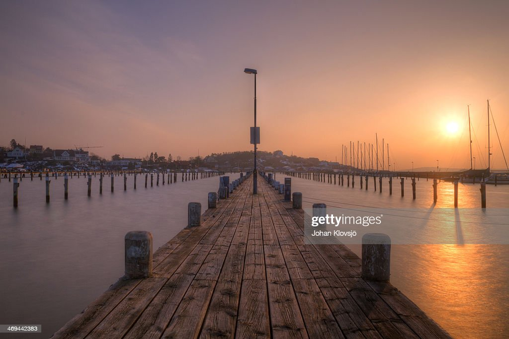 Winter pier at sunset : Stock Photo