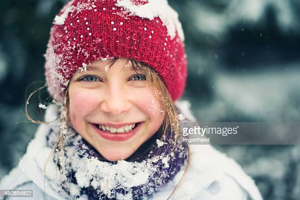 Winter portrait of a little girl laughing