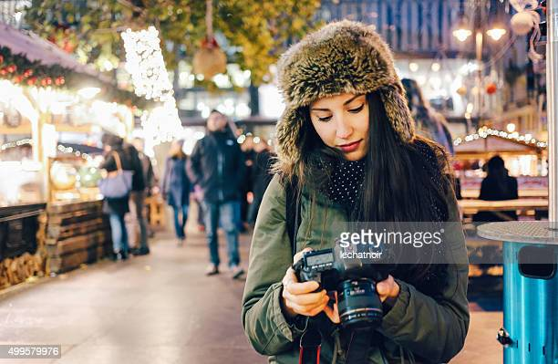 Winter portrait of a smiling young woman photographer