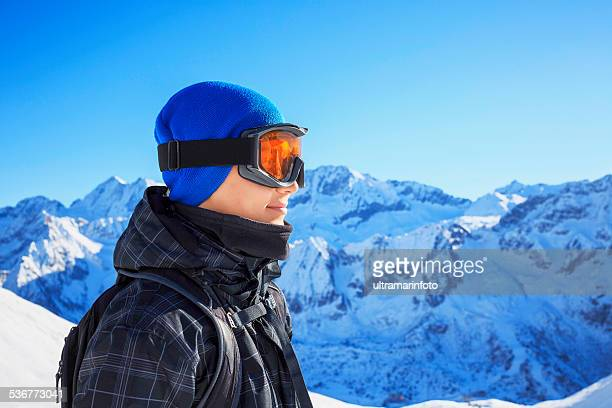 Winter portrait of a teenage boy snow skier