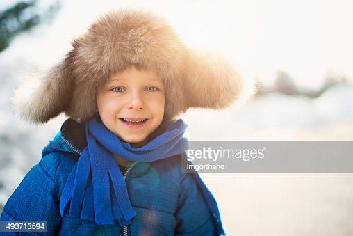 Winter portrait of funny little boy