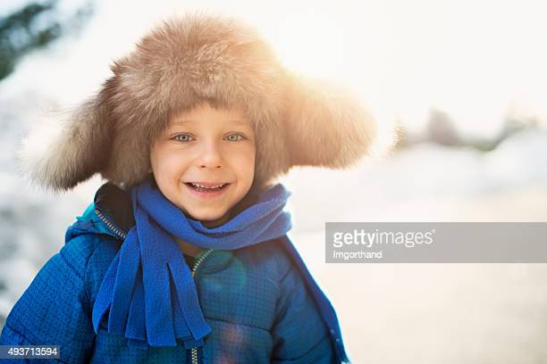 Winter portrait of funny little boy