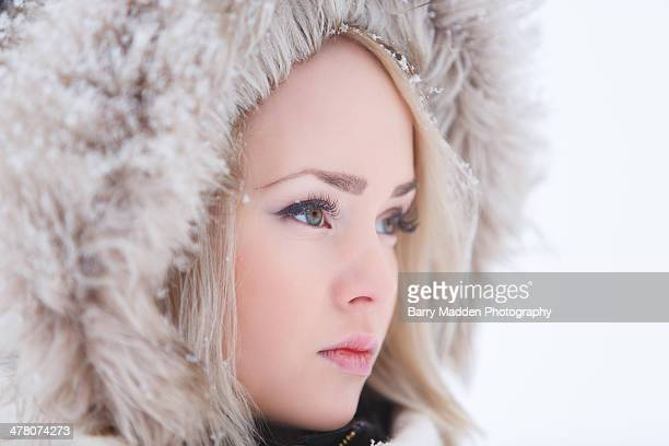 Winter scene closeup of young woman