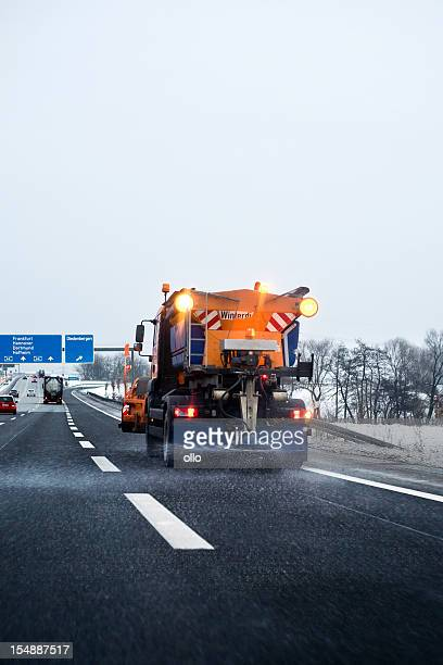 Winter service in action - laying road salt on autobahn