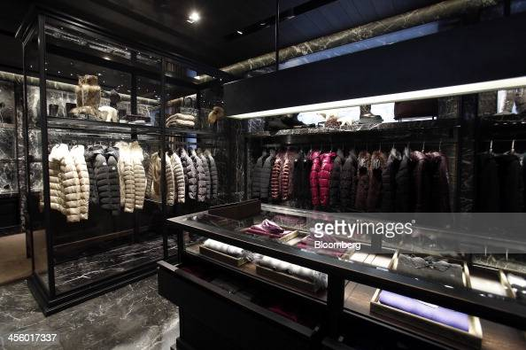Winter ski jackets hang displayed for sale inside a Moncler luxury skiwear store operated by Moncler SpA in Milan Italy on Wednesday Dec 11 2013...