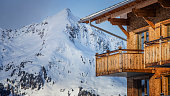 wooden house with snowcapped mountain background, Kuhtai, Tyrol, Austria