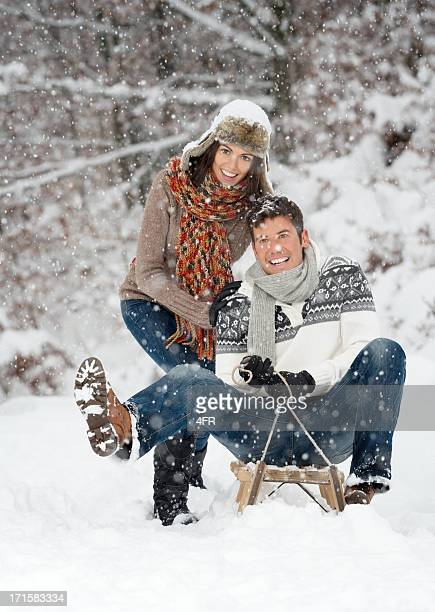 Winter Sled Fun, Couple playing in the Snow