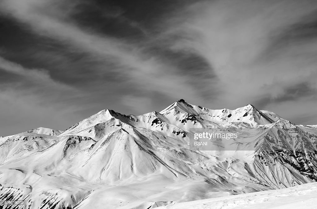 Winter snow mountains in windy day : Stock Photo