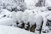 Winter, snowfall in the garden. Table and chairs covered with snow.