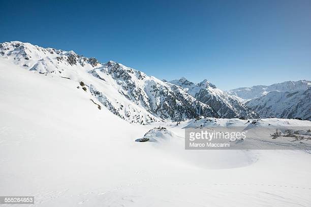 Winter snowy mountain landscape in sunny day