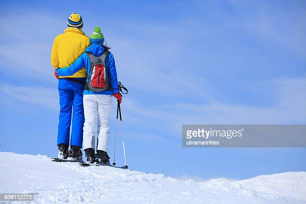 Winter sport   couple men and women snow skiers enjoying resting