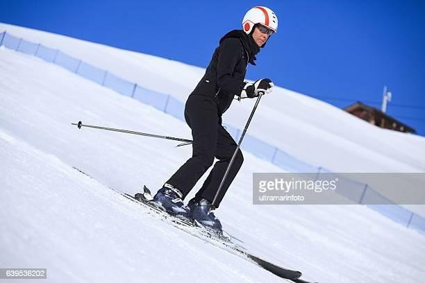 Winter sport  Women snow skier skiing on sunny ski resorts