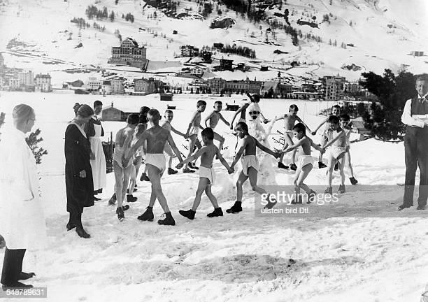 winter sports gymnastics boys dancing in their underwear around a snowman 1930 Photographer Frankl Vintage property of ullstein bild