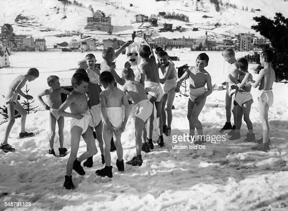 winter - sports, gymnastics: boys in underwear building a snowman ...