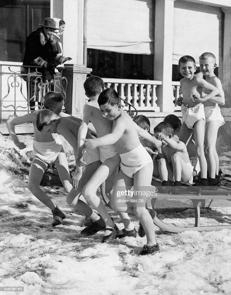 winter - sports, gymnastics: boys in underwear pulling a sleigh ...