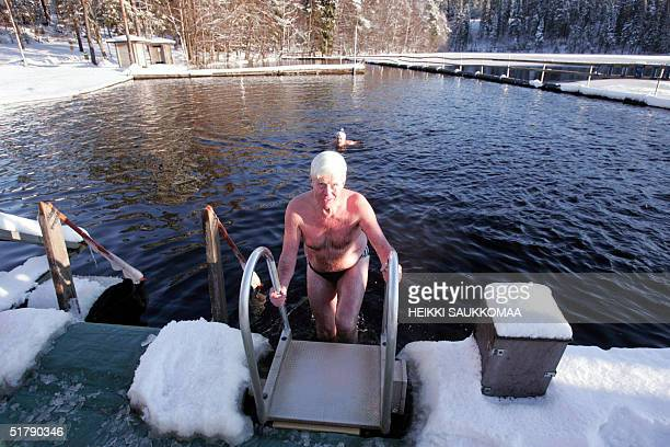 A winter swimmer comes out of icy water in Vantaa near Helsinki 24 November 2004 The usual pattern for winter swimmers is to go to a hot sauna to...