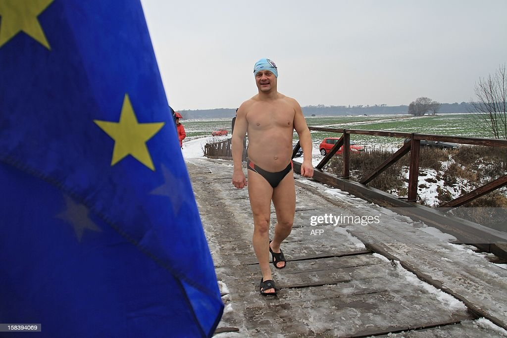 A winter swimmer prepares to swim in the river Thaya near the border to Austria near Breclav, Czech Republic on December 15, 2012. Winter swimmers celebrated the entry of the Czech Republic to the Schengen area on December 21, 2007 and commemorated the victims shot by soldiers in crossing the border to Austria under communism.