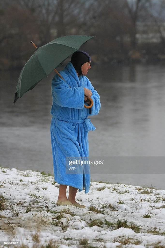A winter swimmer stands at the river Thaya near the border to Austria near Breclav, Czech Republic on December 15, 2012. Winter swimmers celebrated the entry of the Czech Republic to the Schengen area on December 21, 2007 and commemorated the victims shot by soldiers in crossing the border to Austria under communism.