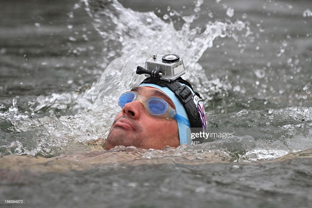 A winter swimmer wears a camera while swimming in the river Thaya near the border to Austria near Breclav, Czech Republic on December 15, 2012. Winter swimmers celebrated the entry of the Czech Republic to the Schengen area on December 21, 2007 and commemorated the victims shot by soldiers in crossing the border to Austria under communism.