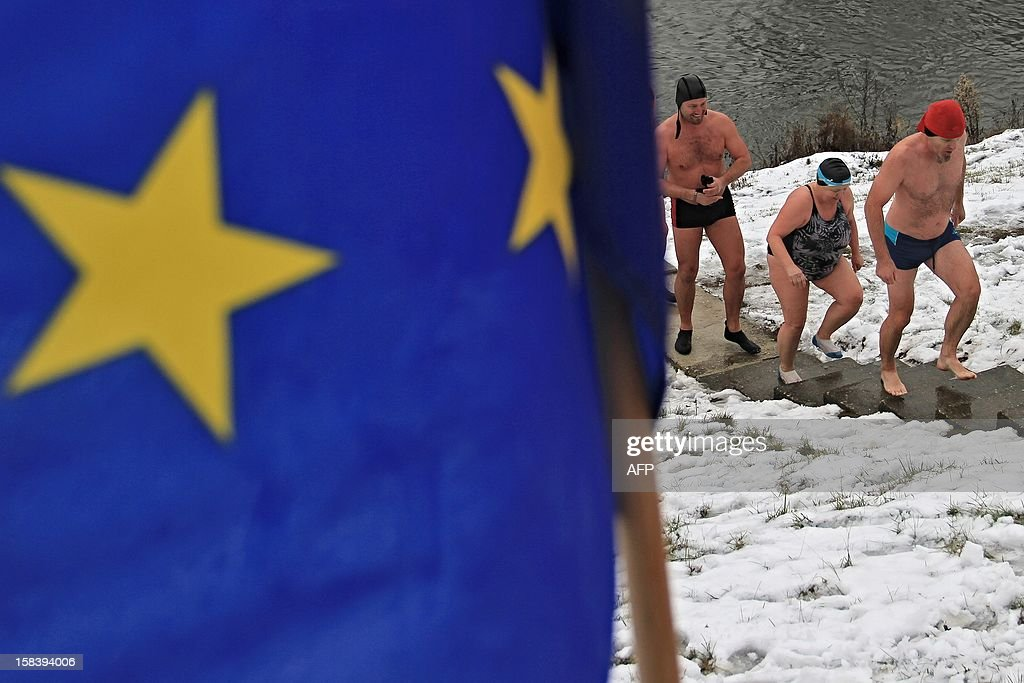 Winter swimmers get off the river Thaya at the border to Austria near Breclav, Czech Republic on December 15, 2012. Winter swimmers celebrated the entry of the Czech Republic to the Schengen area on December 21, 2007 and commemorated the victims shot by soldiers in crossing the border to Austria under communism.